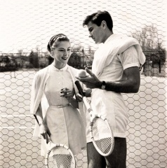 couple playing tennis in 1954