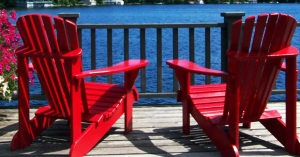 muskoka chairs on a deck